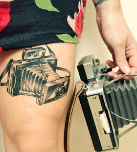 Exciting thigh camera tattoo on leg