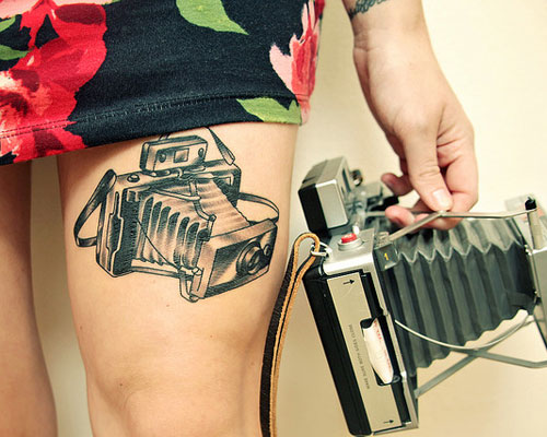 Exciting thigh camera tattoo on leg