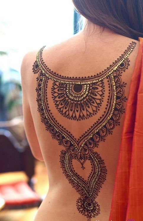 Extremely detailed ornaments tattoo