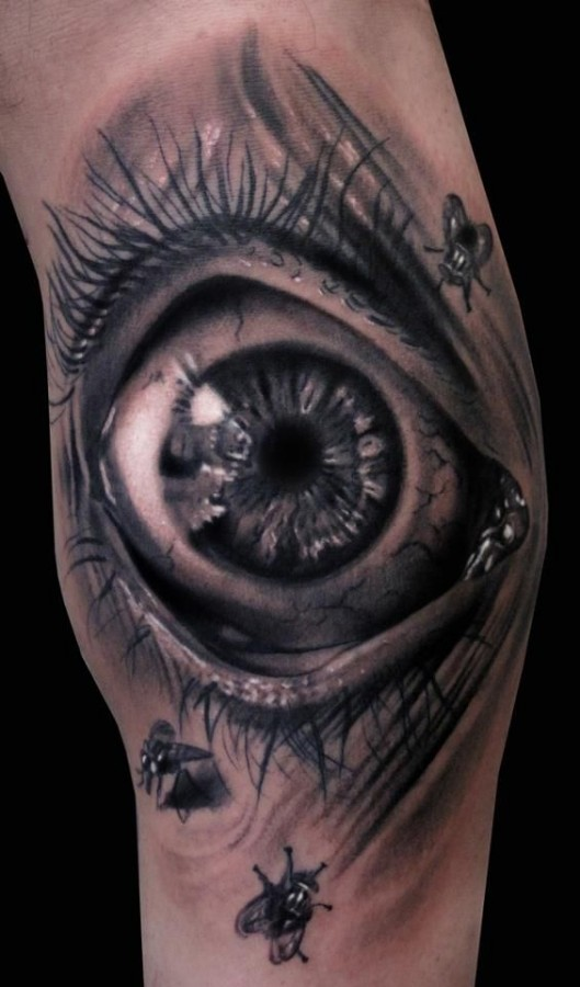 Eye and insect's ornaments tattoo