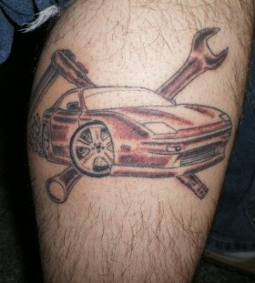 First life car tattoo on leg