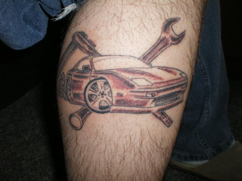 First life car tattoo on leg