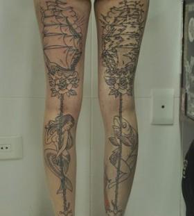 Fish, women and ship tattoo on leg