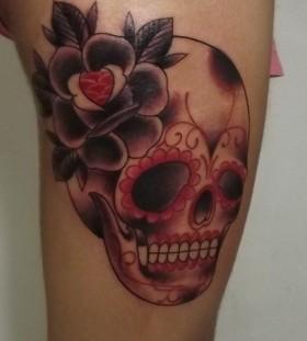 Flower and red skull tattoo on leg