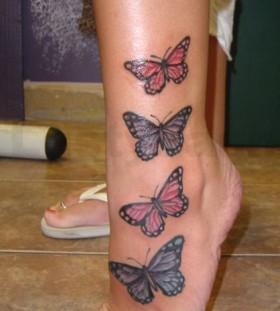 Four women butterfly tattoo on leg