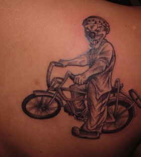 Funny black bicycle tattoo on back