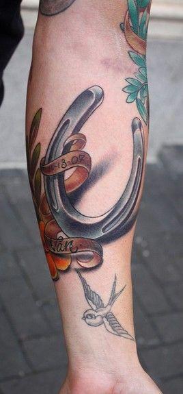 Funny black horse shoe tattoo