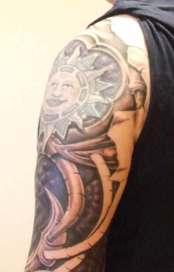 Funny black sun tattoo on arm