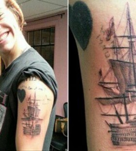 Funny boy's ship tattoo on arm