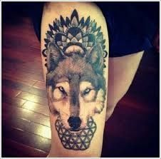 Geometric black wolf tattoo on leg