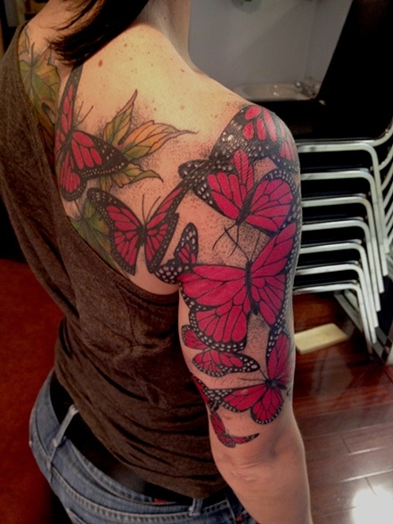 Girl shoulder and arm red butterfly tattooo