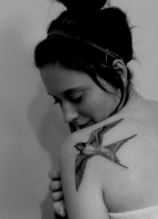 Girl shoulder bird tattoo