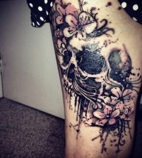 Girl skull and flower tattoo on leg