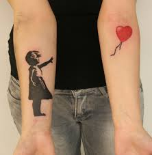 Girl with balloon tattoo on arm