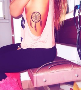 Girl with dream catcher tattoo