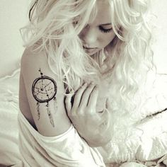 Girl with dream catcher tattoo on arm