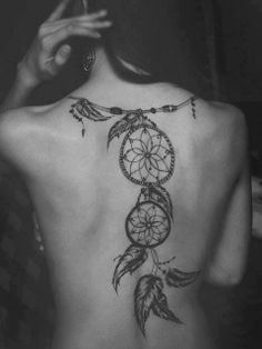Girl with dream catcher tattoo on back