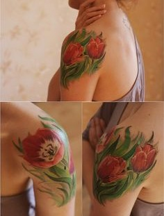 Girl with red tulips tattoo