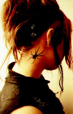 Girl with spider tattoo on neck