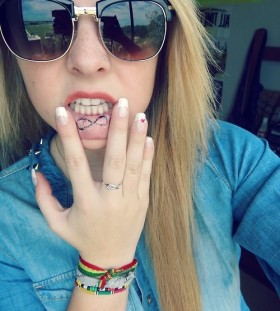 Girl's infinity lips tattoo