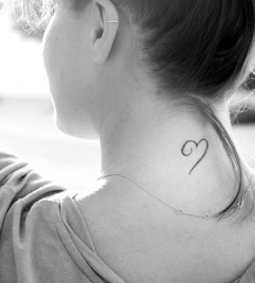 Girl's neck heart tattoo