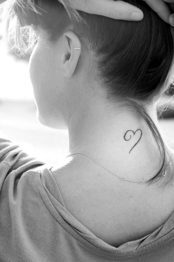 Girl's neck heart tattoo