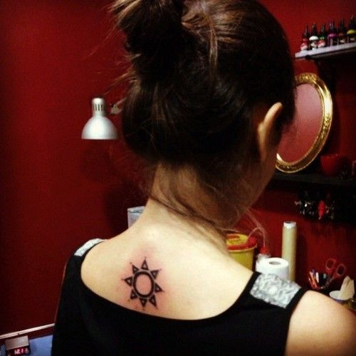 Girl's ornaments back sun tattoo