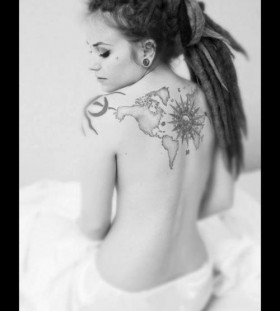 Girl's with dred map tattoo on back