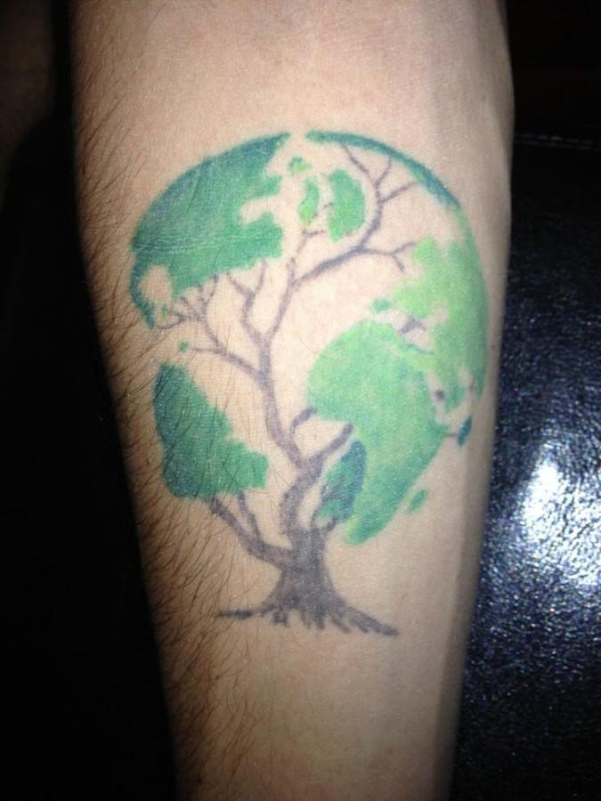 Globe in a tree tattoo