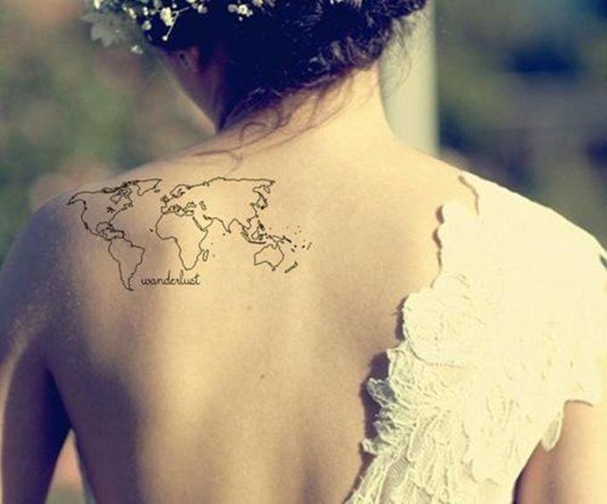 Globe tattoo on back