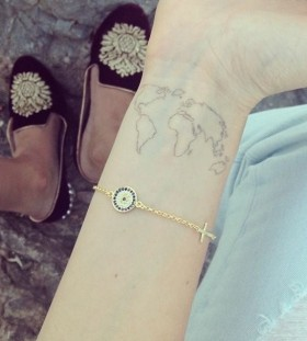 Globe tattoo on wrist