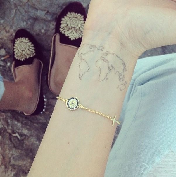 Globe tattoo on wrist