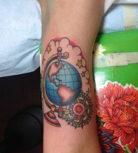 Globe tattoo with compass