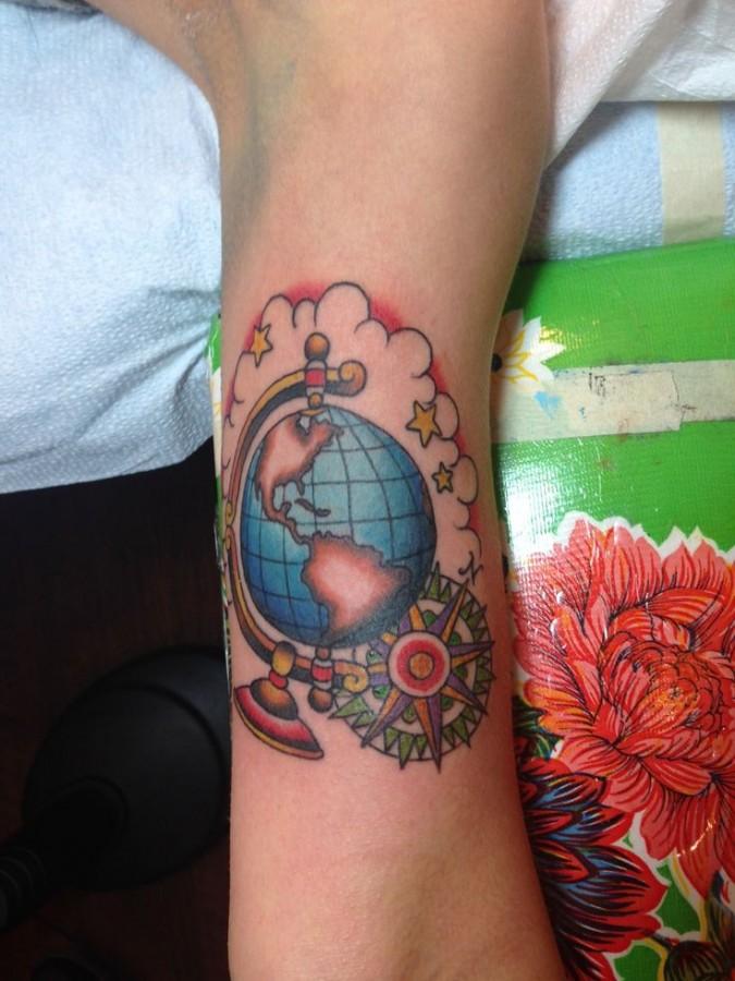 Globe tattoo with compass