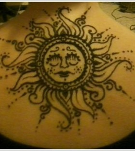 Gorgeous black back sun tattoo