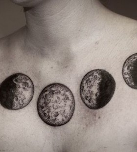 Gorgeous black moon tattoo on shoulder