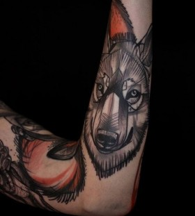 Gorgeous black wolf tattoo on arm