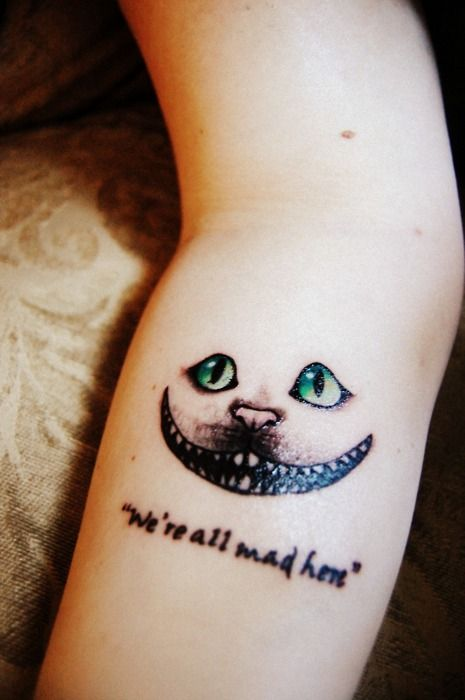 Gorgeous green eye of cat quote tattoo on arm