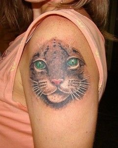 Gorgeous green eyes cat tattoo on arm