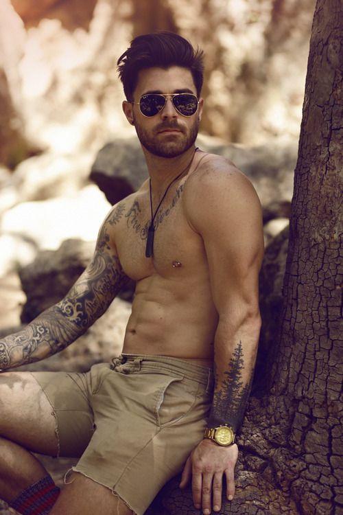 Gorgeous men's tree tattoo on arm