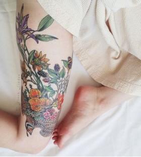 Gorgeous nature flower tattoo on leg