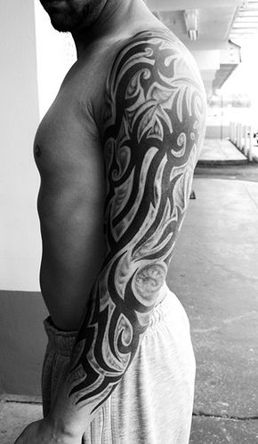 Gorgeous simple tribal tattoo on arm