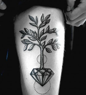 Gorgeous tree crystal tattoo on leg