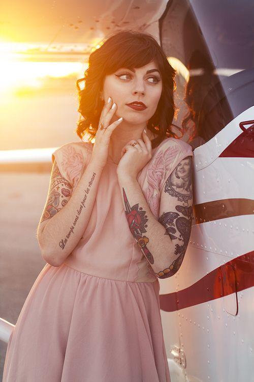 Gorgeous women quote tattoo on arm