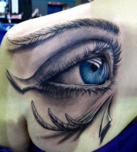 Gorgeous women's eye tattoo on shoulder