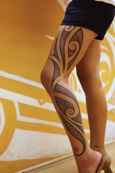 Gorgeous women's line tattoo on leg
