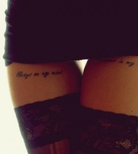 Gorgeous women's quote tattoo on leg