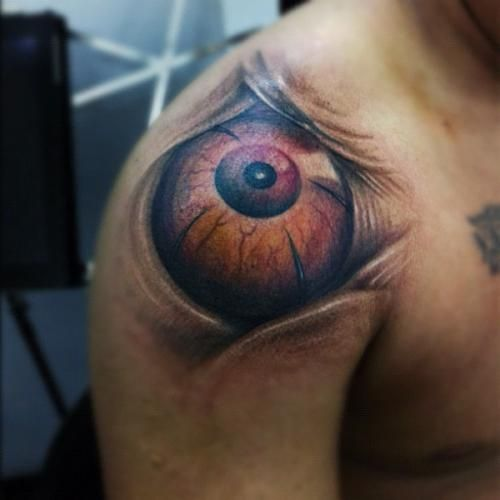 Great brown eye tattoo on shoulder