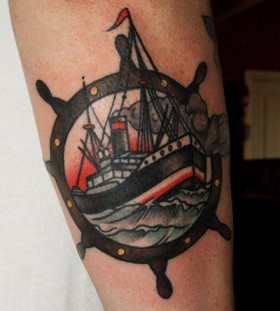 Great looking ship tattoo on arm
