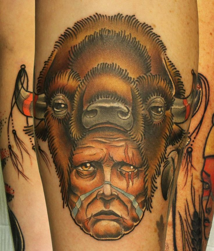 Great men's face tattoo on arm